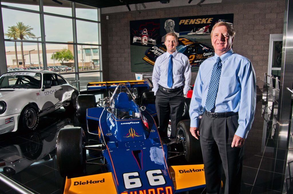 Mark-Taylor vice president of development Chris Brozina (left) and George Brochick, executive vice president of strategic development with Penske Automotive Group.